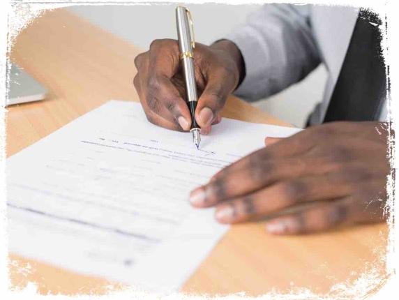 O que significa assinar documentos em sonho