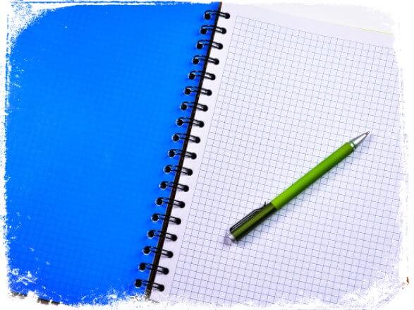 Sonhar com caderno e caneta