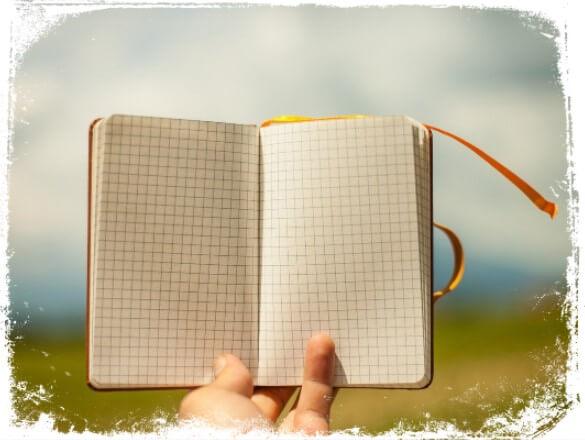 Sonhar com caderno aberto em branco